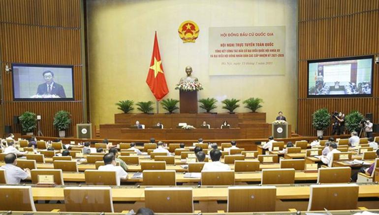Chủ tịch Quốc hội Vương Đình Huệ, Chủ tịch Hội đồng Bầu cử quốc gia chủ trì hội nghị. Ảnh: TTXVN