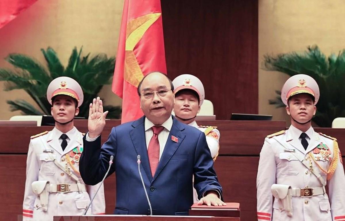 Chủ tịch nước Nguyễn Xuân Phúc tuyên thệ nhậm chức trước Quốc hội, đồng bào và cử tri cả nước. Ảnh: TTXVN