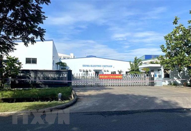 Các doanh nghiệp trong Khu chế xuất Tân Thuận có ca nhiễm COVID-19 tạm ngừng hoạt động để phòng dịch. Ảnh: TTXVN